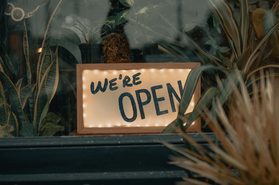 We're OPEN sign   Business Owners Insurance